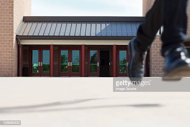 male high school student running away from school - low section stock pictures, royalty-free photos & images