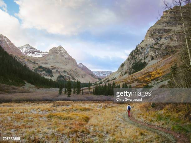 male hiker alone in the backcountry wilderness of colorado - maroon bells stock photos and pictures