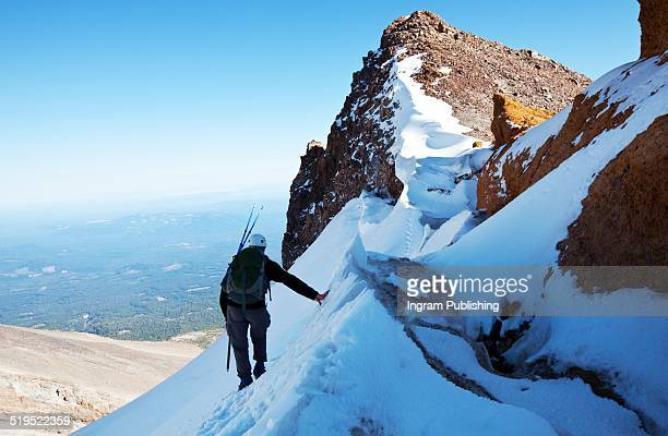 male hiker climbing on mount shasta - mt shasta stock pictures, royalty-free photos & images