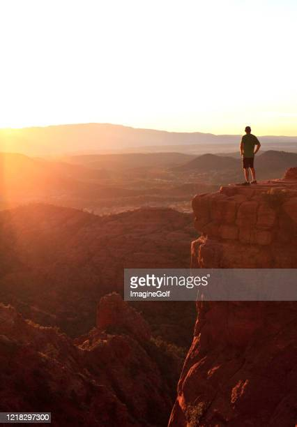 male hiker in sedona at dramatic viewpoint at sunset - arizona stock pictures, royalty-free photos & images