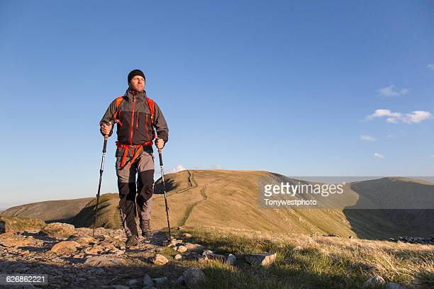 male hiker in the mountains of england - trousers stock pictures, royalty-free photos & images