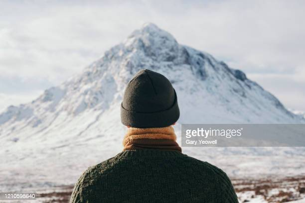 male hiker in winter mountain landscape - scotland stock pictures, royalty-free photos & images