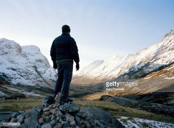 male hiker in winter mountain landscape - landscape stock pictures, royalty-free photos & images