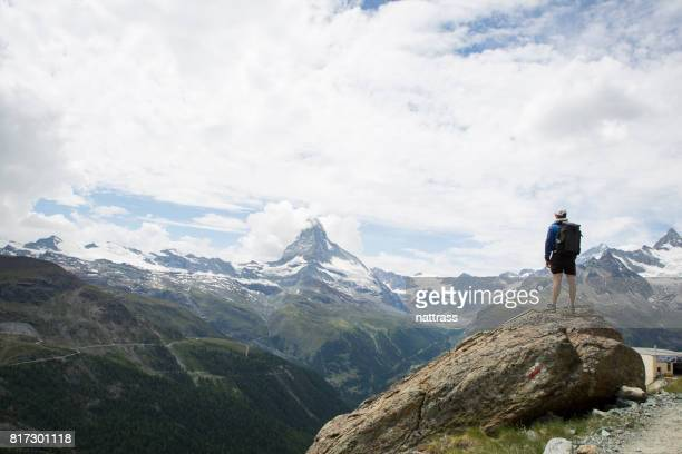 male hiker looking at the view - auvergne rhône alpes stock pictures, royalty-free photos & images