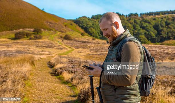 male hiker on a staycation in the hills of northern england - hill stock pictures, royalty-free photos & images