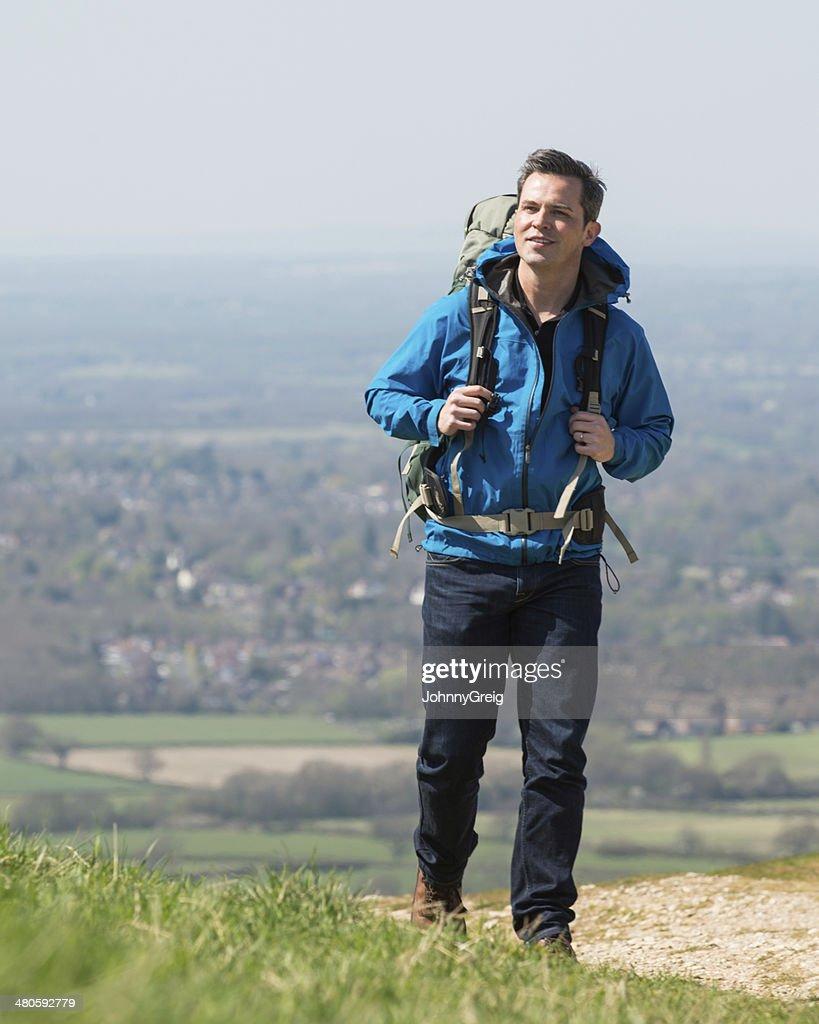 Male Hiker On Hillside Walk : Stock Photo