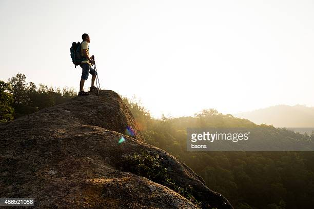 Male hiker standing on a rock