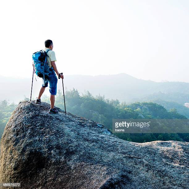 Male hiker standing on a rock