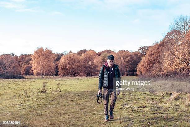 Male hiker walking in forest in Autumn