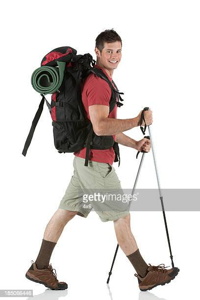 Male hiker walking with hiking poles