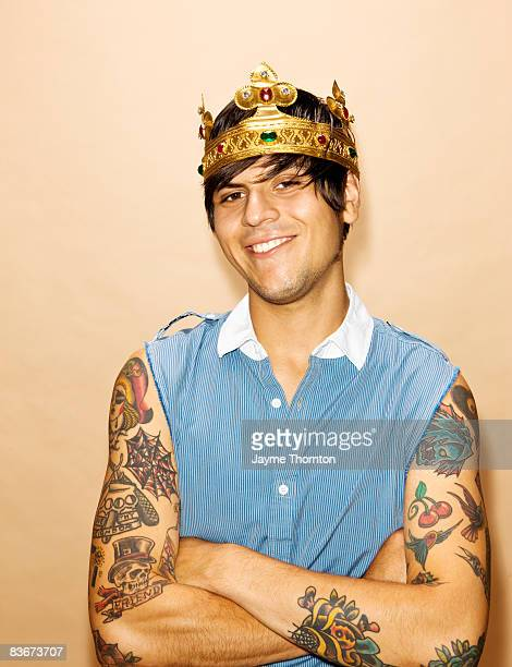 Male hipster wearing crown