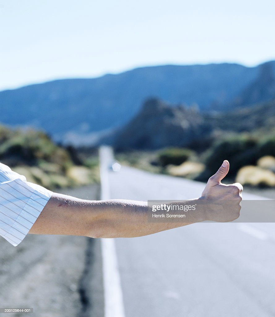 Hitchhikers By Side Of Road >> Male Hitchhiker At Side Of Road Arm Outstretched Closeup Stock Photo