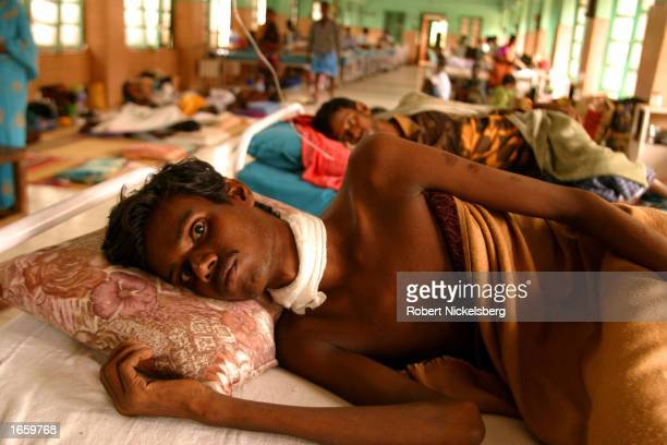 A male HIV patient lies in bed November 5 2002 at the Government Hospital of Thoracic Medicine in the city of Tambaram in the Indian state of Tamil...