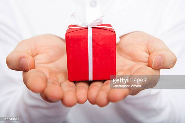 Male holding christmas present