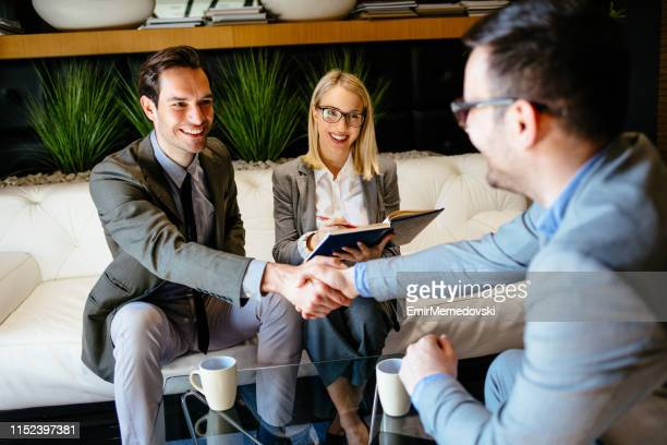 male hr manager shaking hands with job applicant - candidate stock pictures, royalty-free photos & images