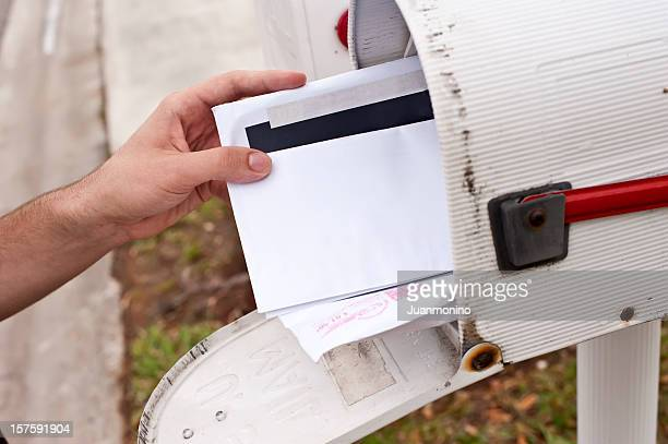 Male human hand getting the mail