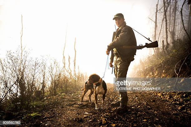 Male hunter with dog in the forest