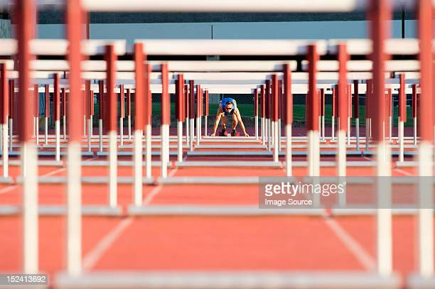 Male hurdler at starting line