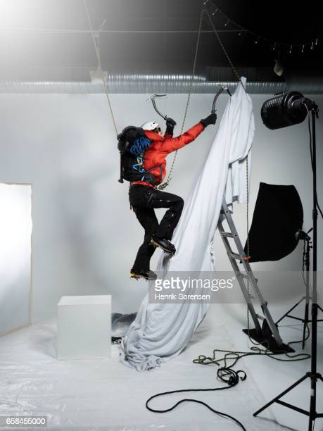 Male ice climber in a studio