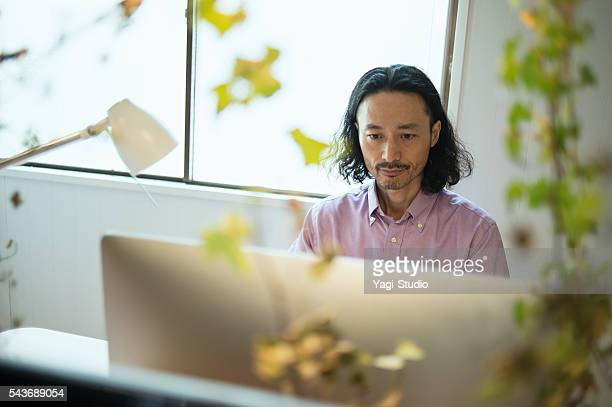 Male Interior designer using computer in design studio
