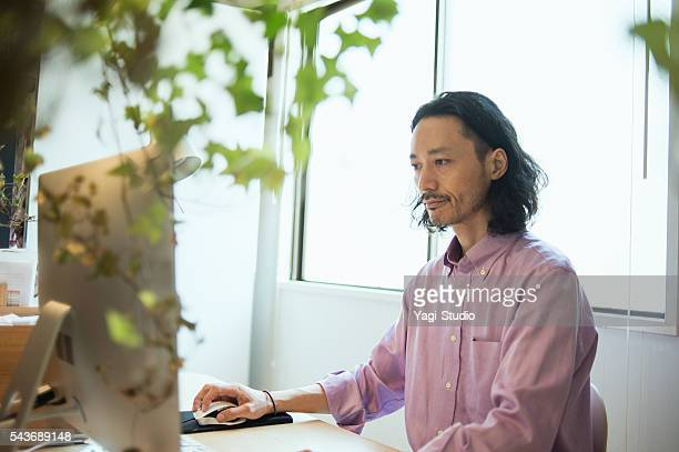 Male Interior designer using computer in design studio