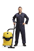 Male janitor with a professional hoover