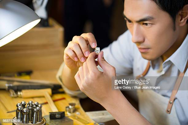 Male jeweler making a ring