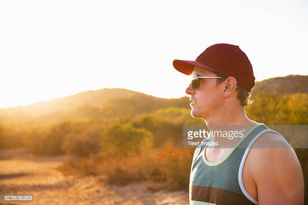 Male jogger in sunglasses and baseball cap, Poway, CA, USA