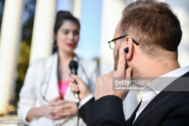 male journalist asking female activist questions during press conference outside - presidential candidate stock pictures, royalty-free photos & images