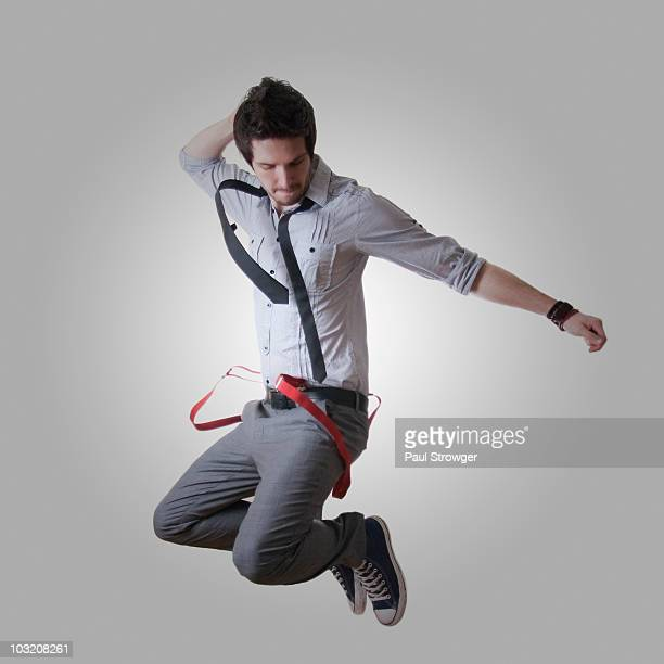 Male Jumping with Red Braces