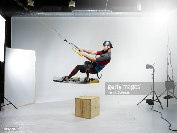 Male kitesurfer in a studio