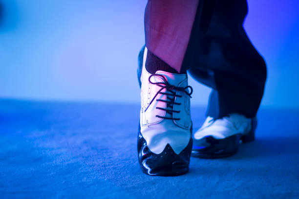 a6b5be079 ... Male latin and salsa dancer in black and white jazz dancing shoes in  light and dark ...