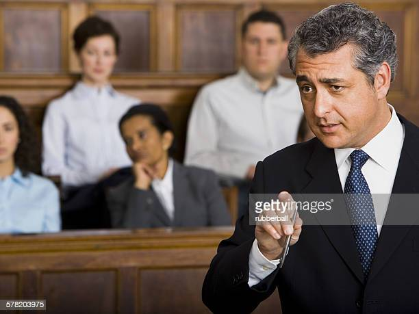 A male lawyer talking in a courtroom