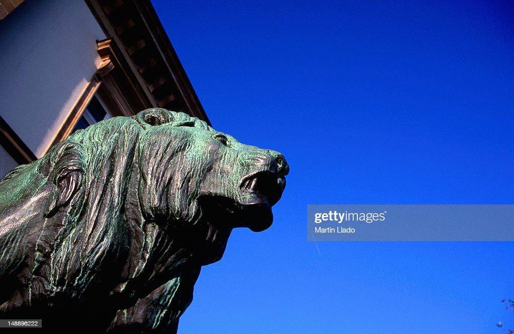 Male Lion Statue Guarding Hotel De Ville On Place