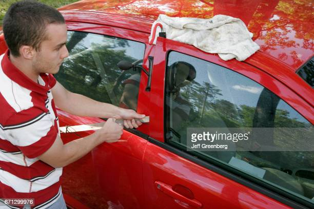A male locksmith unlocking a car at the Historic Blakeley State Park