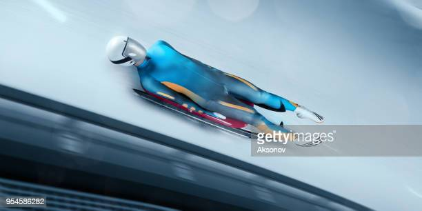 male luge athlete in professional luge track - luge stock pictures, royalty-free photos & images