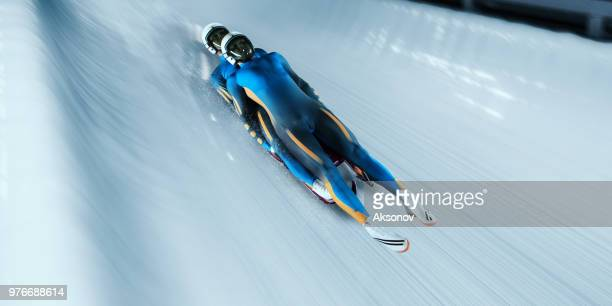 male lugers couple in professional luge track - luge stock pictures, royalty-free photos & images