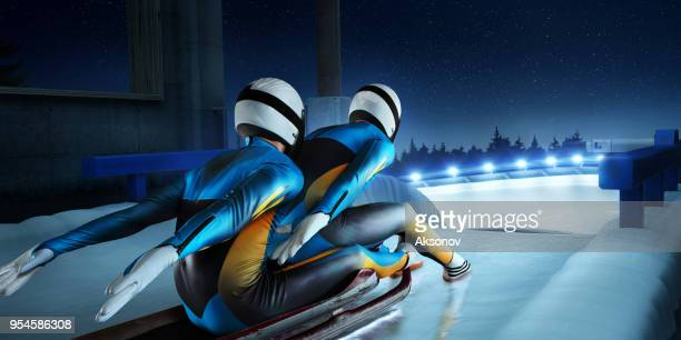 male lugers couple in start line on luge track - luge stock pictures, royalty-free photos & images
