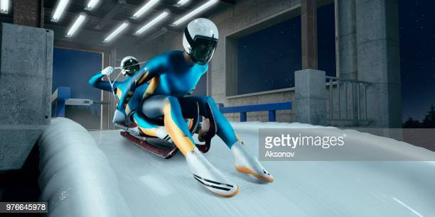 couple de lugeurs masculins dans la ligne de départ sur la piste de luge - événement sportif d'hiver photos et images de collection