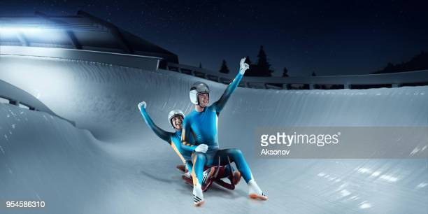 Male Lugers Couple rejoice at victory on Luge Track