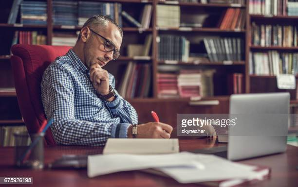 male manager taking notes in home office. - writing stock pictures, royalty-free photos & images