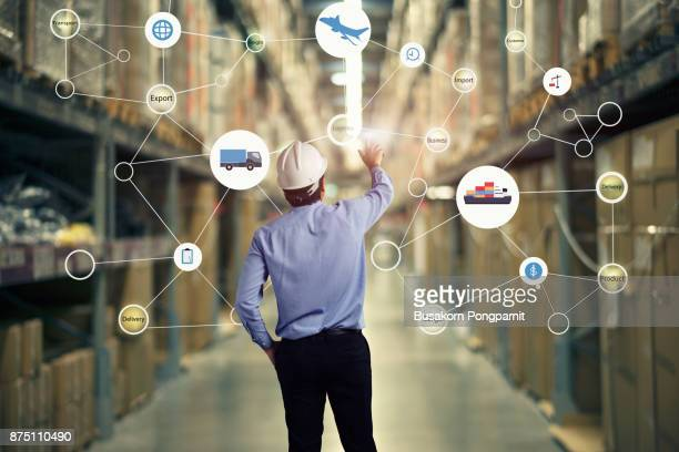 male manager workers in warehouse - heavy industry stock photos and pictures
