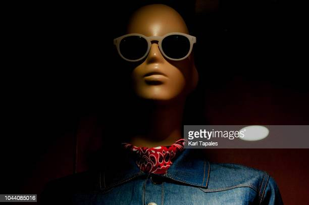 a male mannequin wearing current clothing trends - capital region stock pictures, royalty-free photos & images