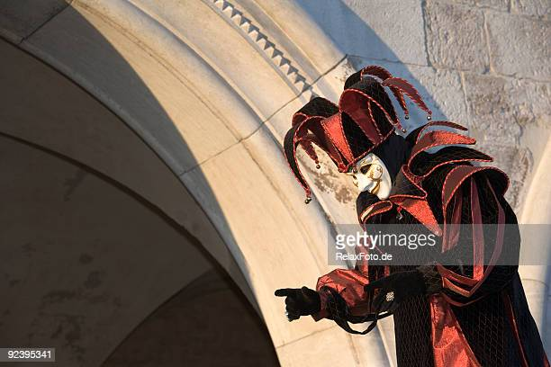 male mask with jester costume at carnival in venice (xl) - harlequins stock pictures, royalty-free photos & images