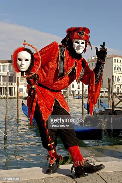 male mask with red harlequin costume at carnival in venice - harlequins stock pictures, royalty-free photos & images