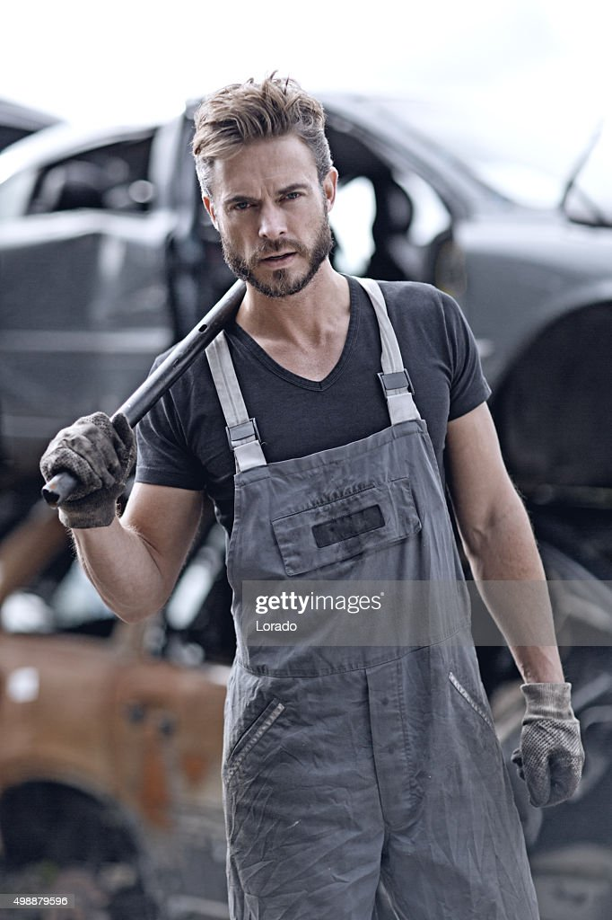 Male mechanic at junkyard : Stock Photo