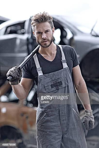 male mechanic at junkyard - junkyard stock photos and pictures