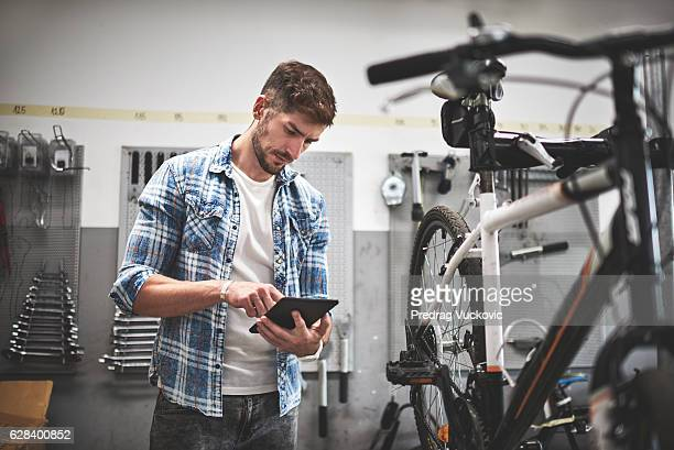 Male mechanic in bicycle store