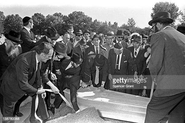 Male members of a synagogue attend a burial ceremony, Mattapan, Massachusetts, 1971.
