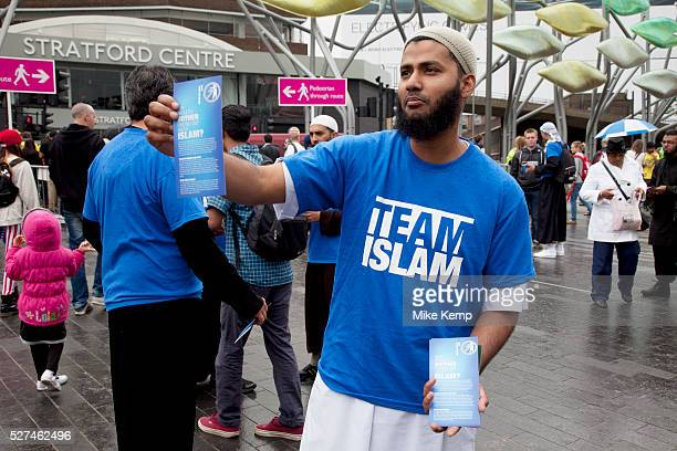 Male members of Team Islam giving out leaflets about their religious Islamic faith in Stratford East London UK Very peacefully they pass on the...